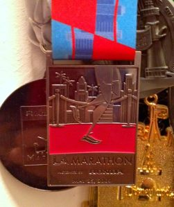 "LA Marathon '09 medal. Kinda ""Meh"" and ""Wonderful"" at the same time."